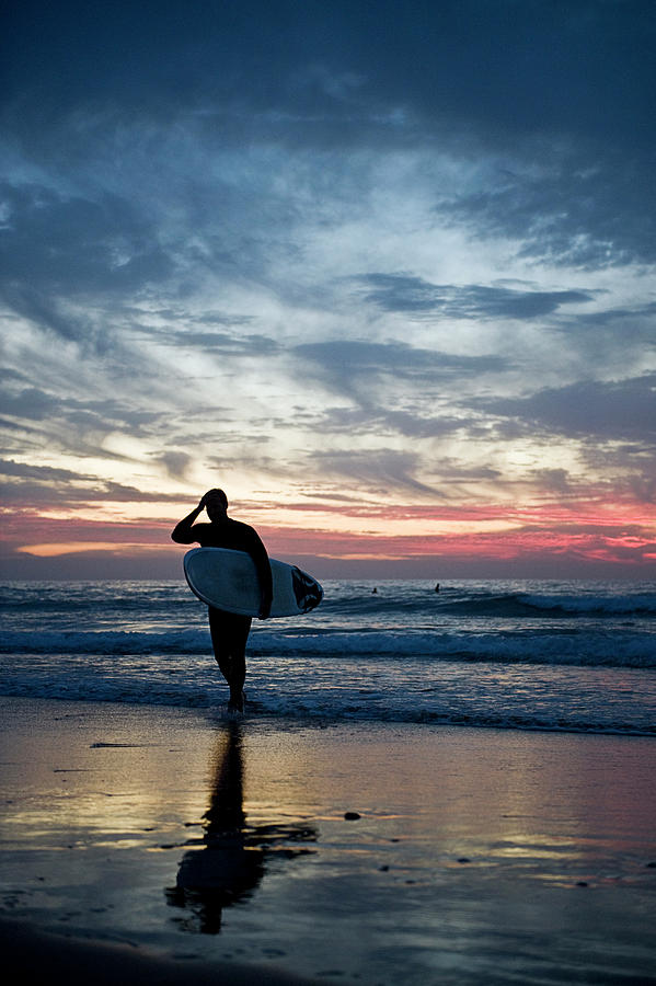 Surfer At The Ocean At Sunset Photograph by Daniel Reiter / Stock4b