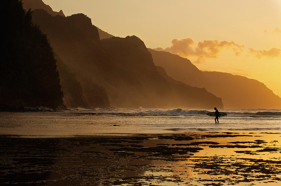 Surfer On Beach And Na Pali Coast Seen Photograph by Enrique R. Aguirre Aves