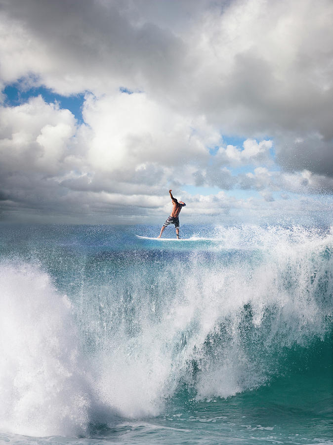 Surfer Surfing On Wave, Rear View Photograph by Ed Freeman