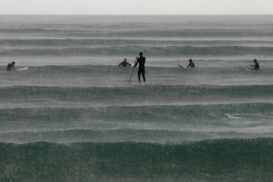Surfers On The Rain