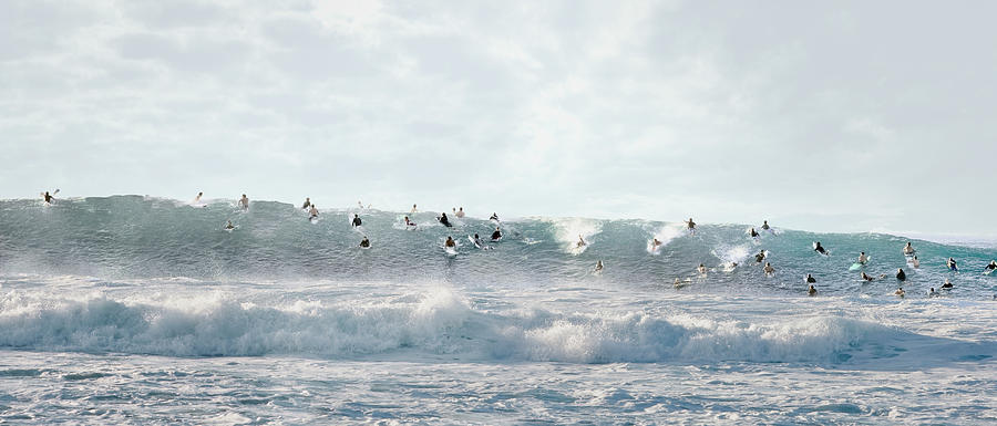 Surfers Surfing On Wave Photograph by Ed Freeman