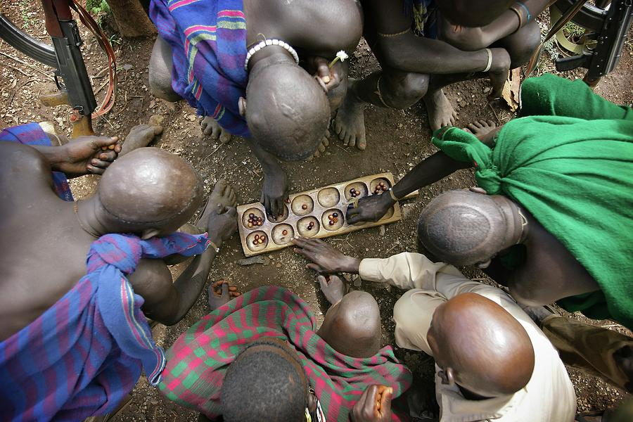 Suri Tribal Game Of Mancala Seen From Photograph by Timothy Allen