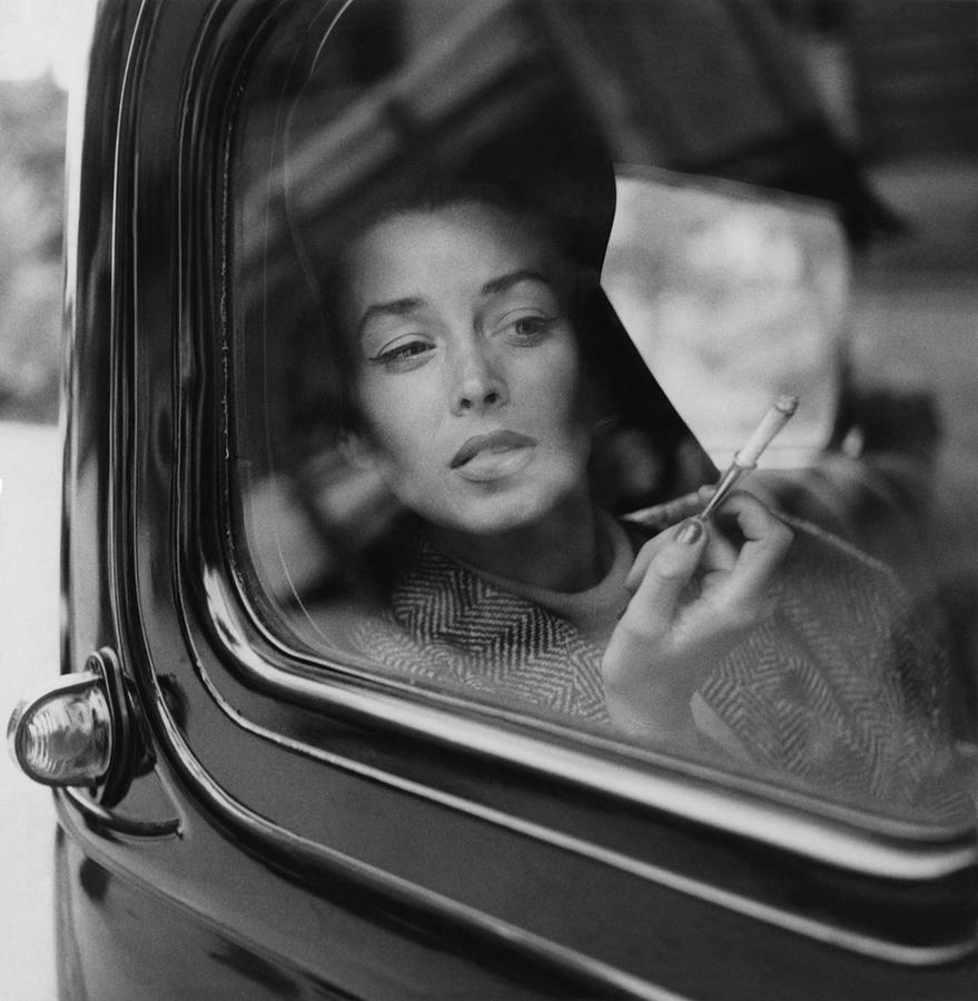 Suzy Parker Snapshot Of Dorian Leigh Photograph by Conde Nast