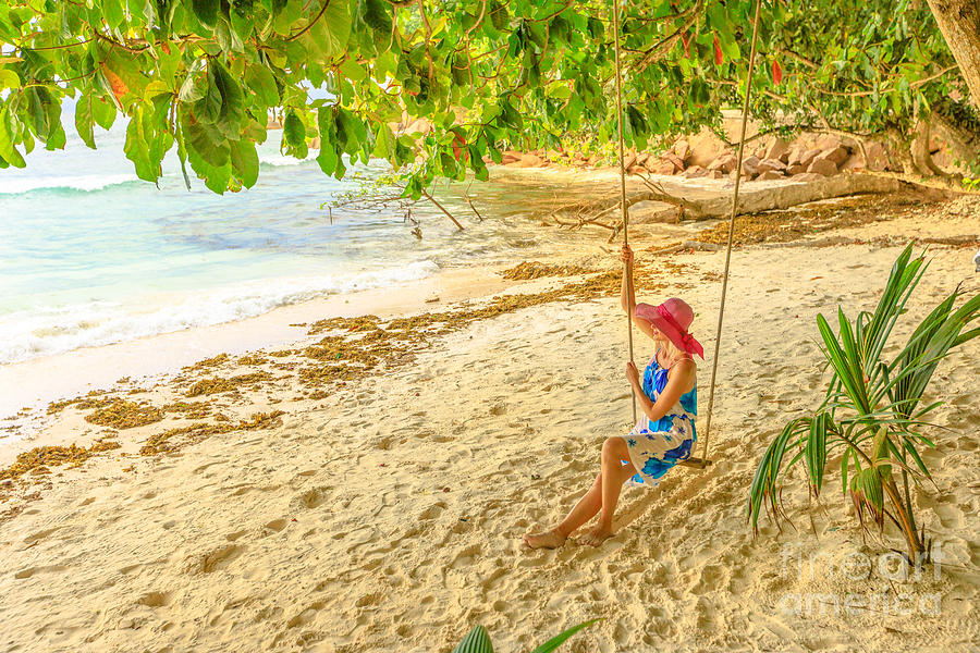 Swinging at La Digue by Benny Marty
