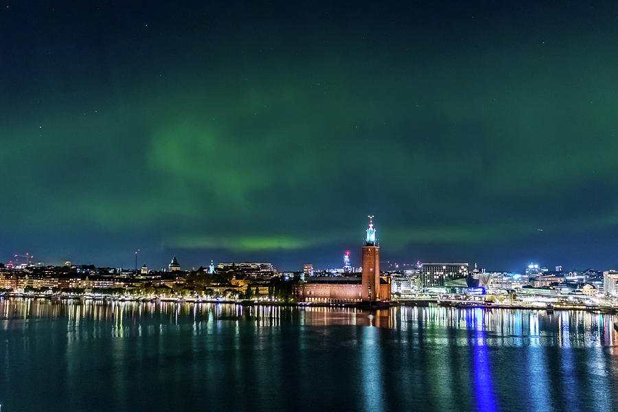 Aurora Borealis Photograph - Swirly Aurora over the Stockholm City Hall and Kungsholmen by Dejan Kostic