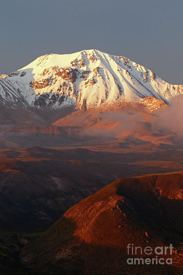 Taapaca Volcano at Sunset Chile by James Brunker