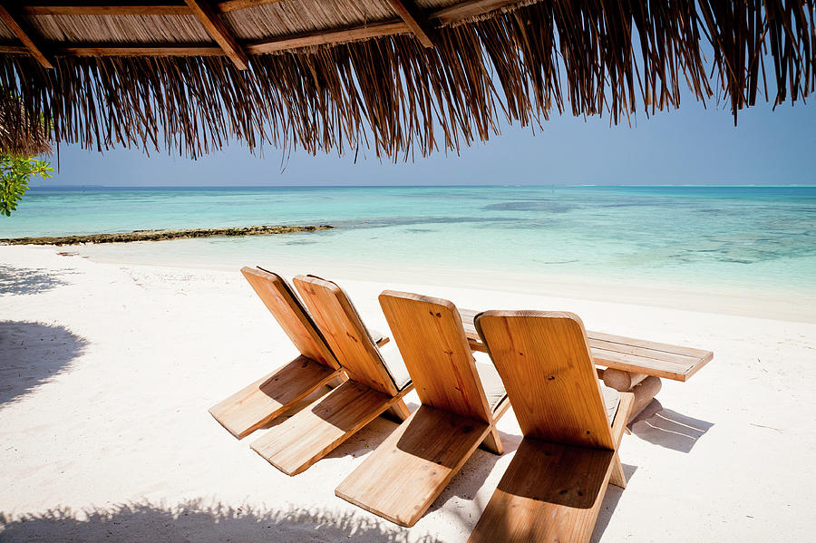 Table And Chairs On A White Sandy Beach Photograph by Mauro grigollo
