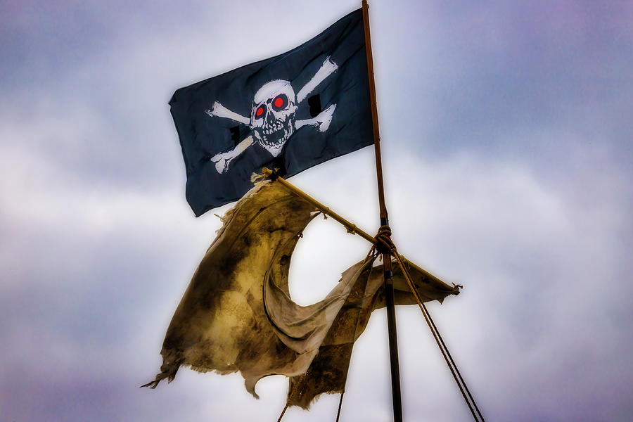 Flags Photograph - Tattered Sail And Pirate Flag by Garry Gay