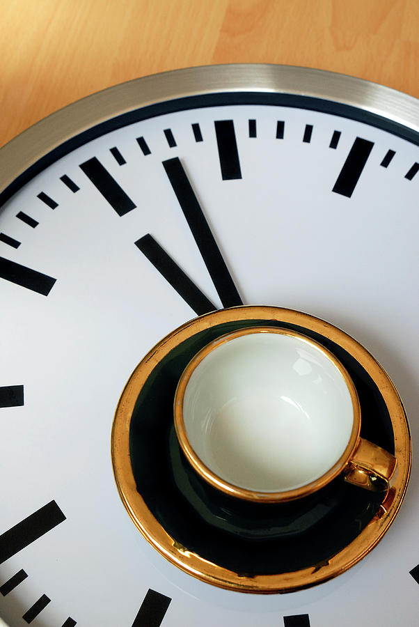Teacup On A Clock Photograph by Eversofine