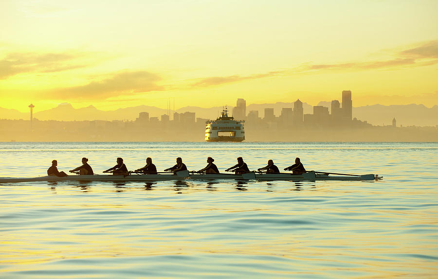 Team Rowing Boat In Bay Photograph by Pete Saloutos