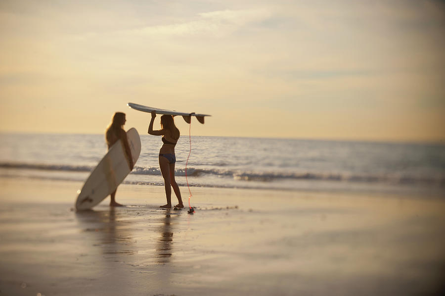 Teen Girls With Surfboards Discussing Photograph by Stephen Simpson