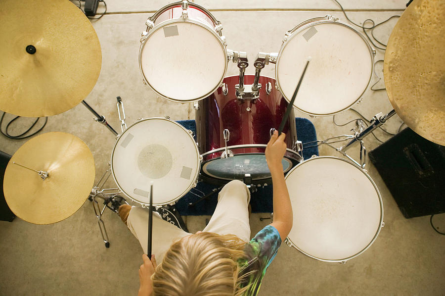Teenage Boy 13-15 Playing Drums Photograph by Bill Reitzel