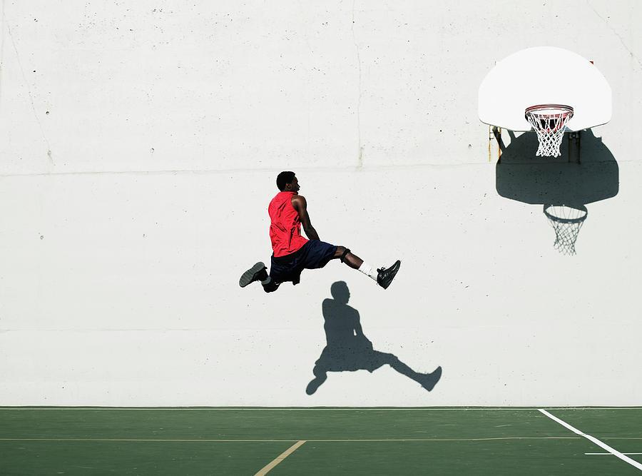 Teenage Boy 16-18 Dunking Basketball On Photograph by Thomas Barwick