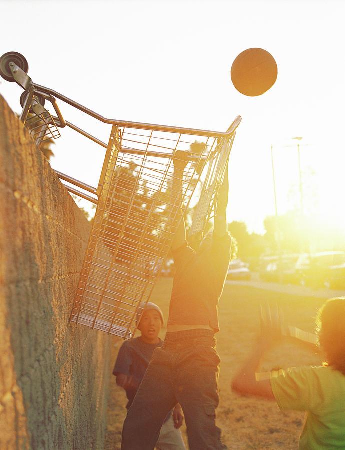 Teenage Boys 13-15 Playing Basketball Photograph by Sean Murphy