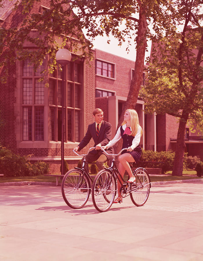 Teenage Couple Riding Bicycles Past Photograph by H. Armstrong Roberts