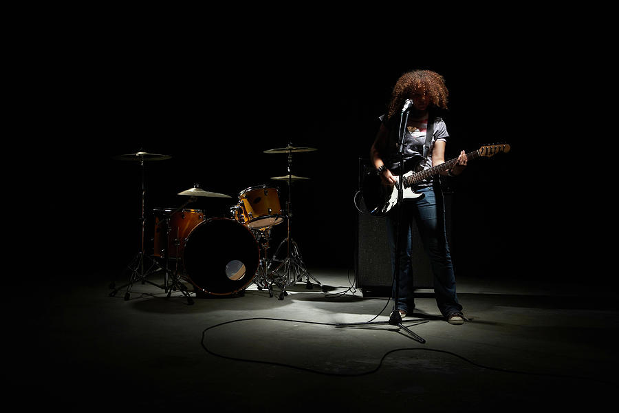 Teenage Girl 13-15 Playing Electric Photograph by Thomas Northcut