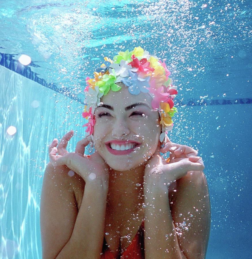 Teenage Girl 16-18 Underwater In Pool Photograph by Nancy Brown