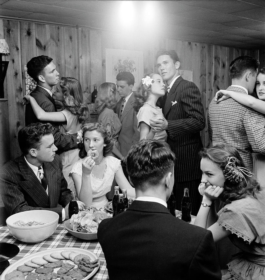 Teenagers Dancing And Socializing At A Photograph by Nina Leen