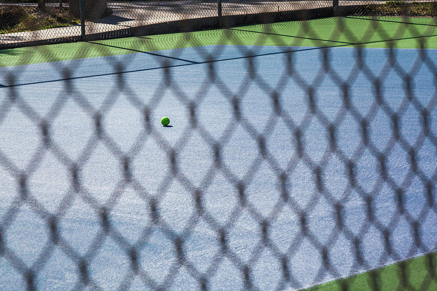 Tennis Ball Alone On Court by Jeanette Fellows