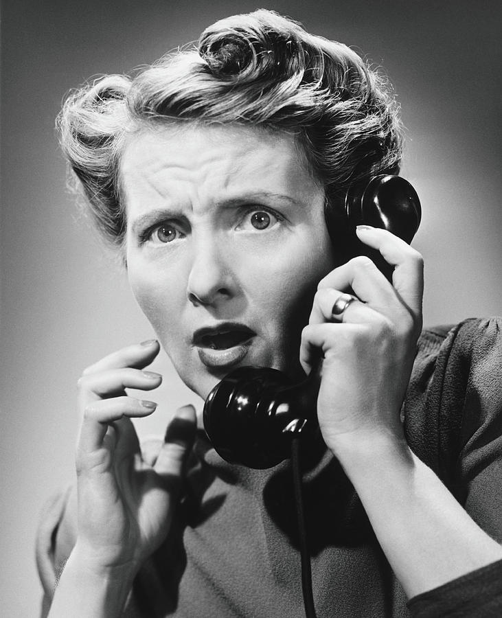 Terrified Woman Talking On Phone, B&w Photograph by George Marks