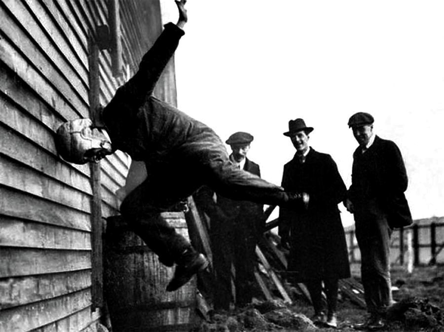 Testing Football Helmets - circa 1913 by Doc Braham