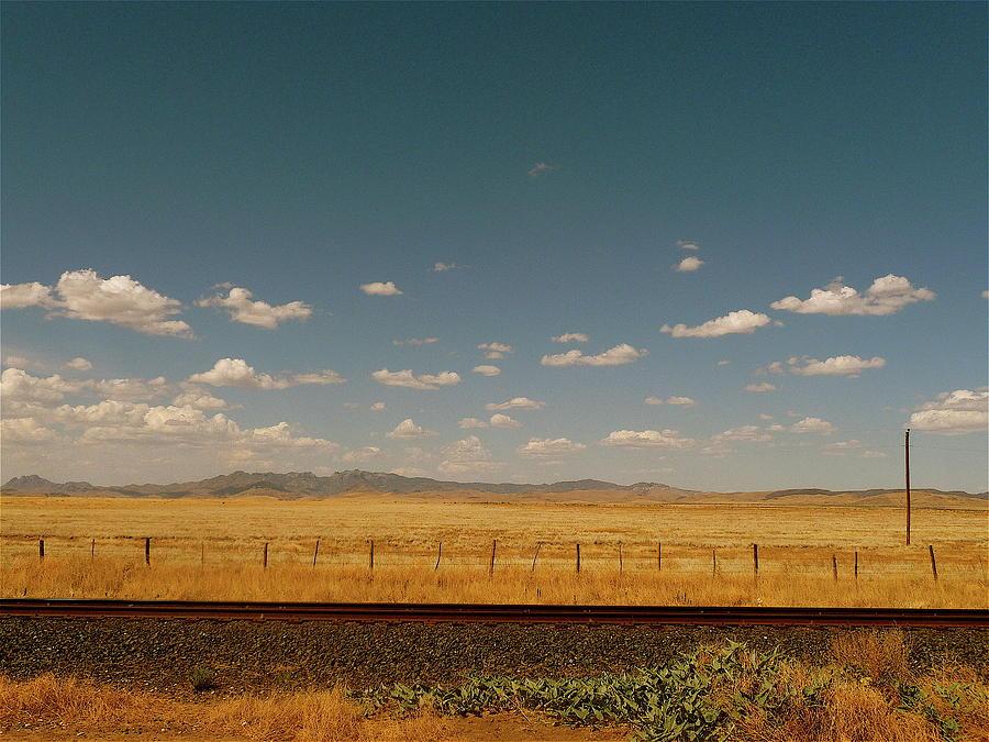 Texan Desert Landscape And Rail Tracks Photograph by Papilio