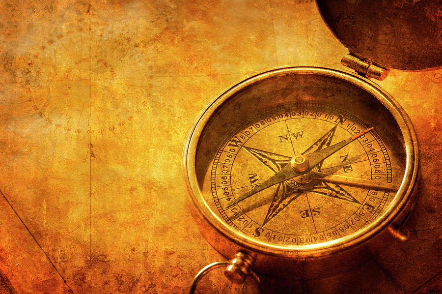 Textured Compass On Top Of Old Map Photograph by Dny59