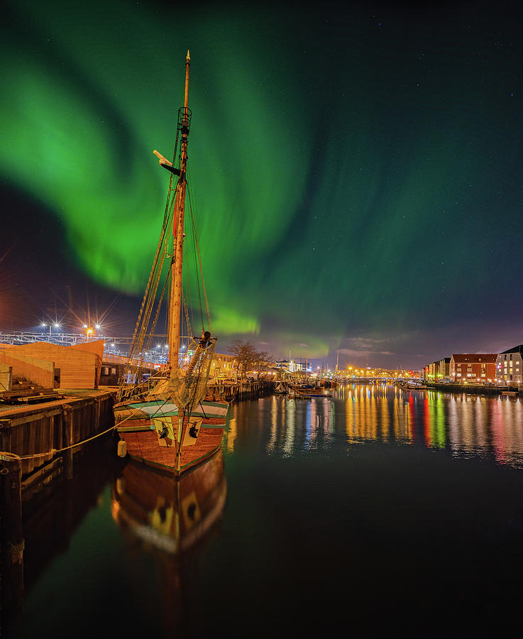 The amazingl night over Trondheim's Canal with Northern Light  by Aziz Nasuti