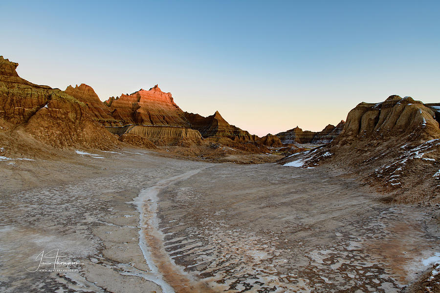 Badlands Photograph - The Badlands And A Sunrise by Jim Thompson