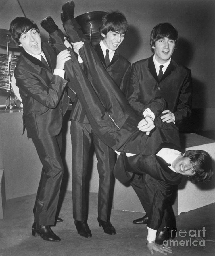 The Beatles Holding Ringo Starr Photograph by Bettmann