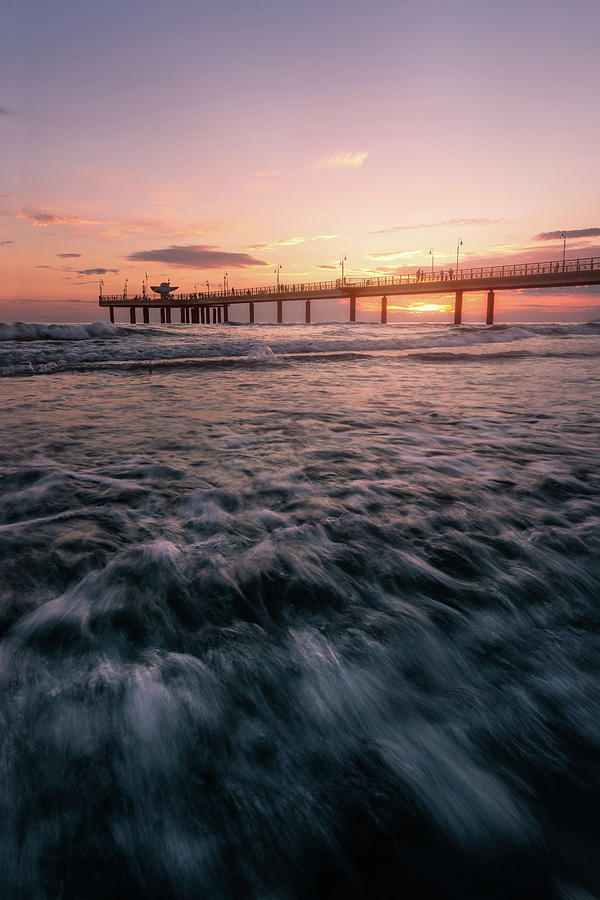 The Fiery pier - a pier at sunset in Versilia, Tuscany, Italy by Matteo Viviani