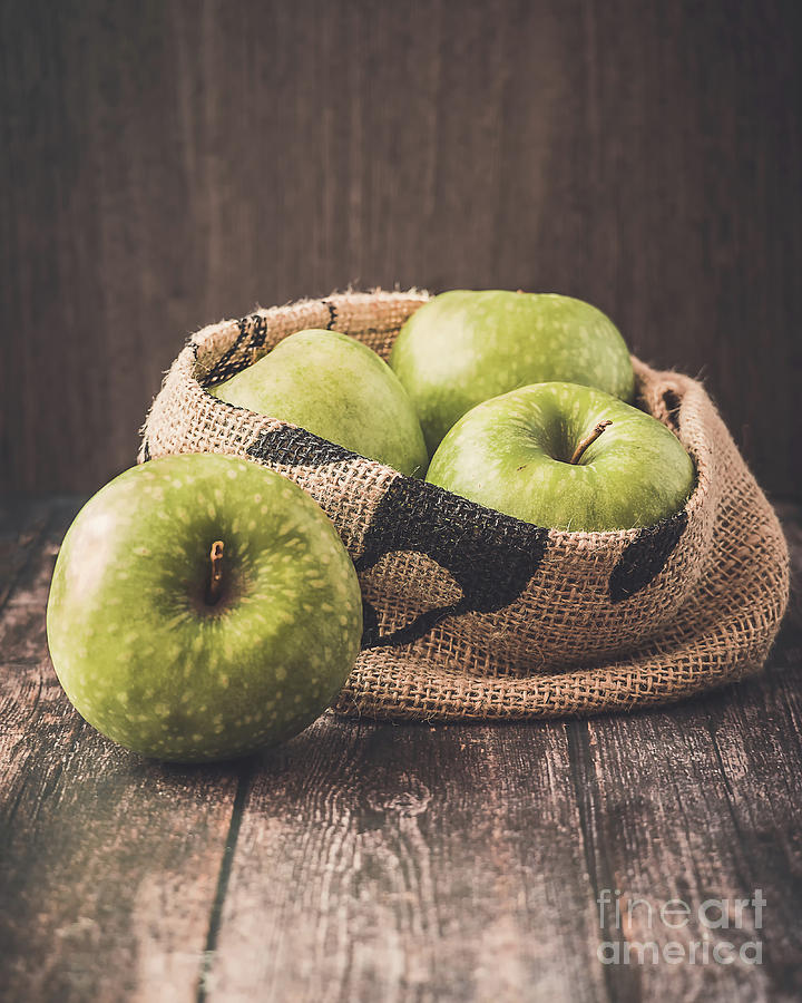 The green apples in a canvas bag by Marina Usmanskaya