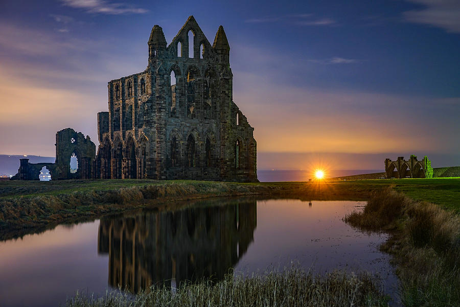 The Historic Whitby Abbey In England Seen On A Beautiful Night. Photograph