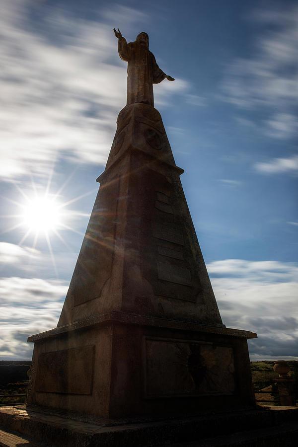 The medinaceli christ under blue sky and sun by Vicen Photography