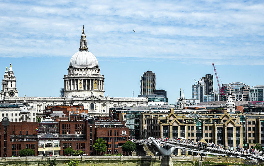 The Millennium bridge and St Pauls cathedral in central London by Michalakis Ppalis
