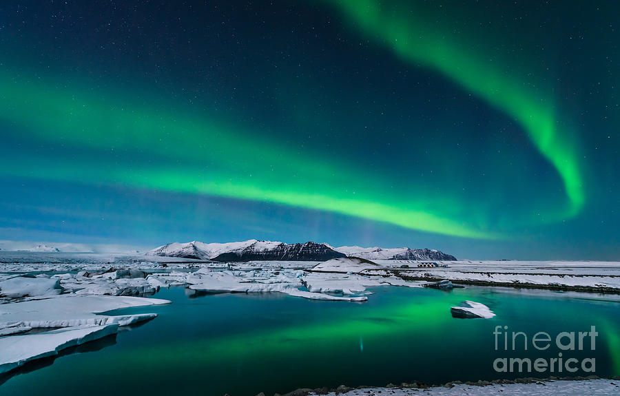 Tide Photograph - The Northern Lights Dance Over The by John A Davis