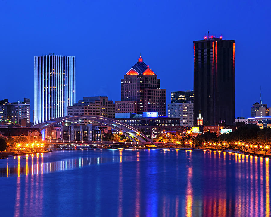 The Rochester Skyline reflecting the the Genesee River Rochester NY Blue Building by Toby McGuire