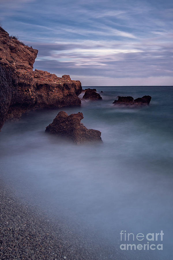 The rocks and the sea by Hernan Bua