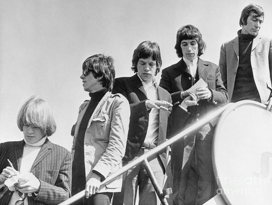The Rolling Stones Getting Off Plane Photograph by Bettmann
