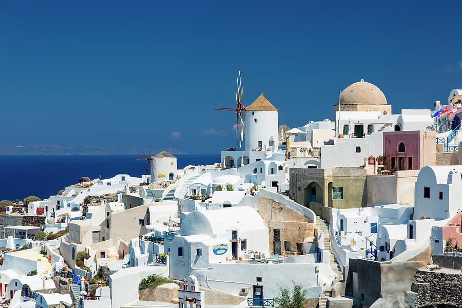 The Small Greek Village Of Oia Photograph by Sylvain Sonnet