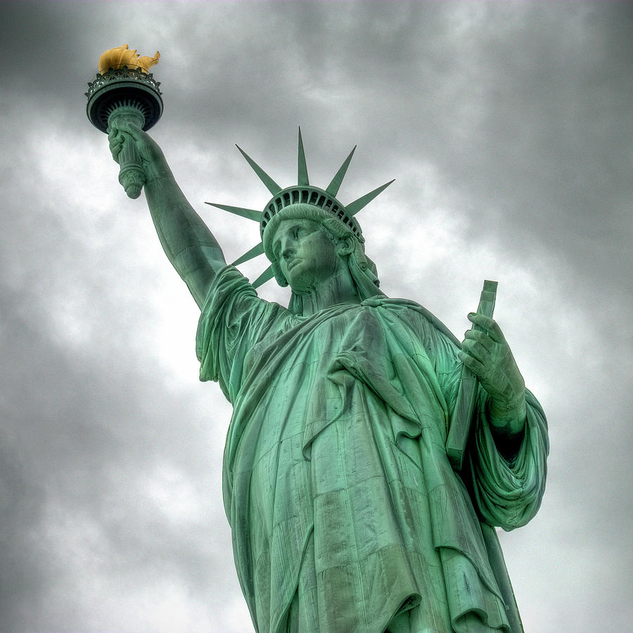 The Statue Of Liberty Nyc Under A Photograph by Marcel Germain