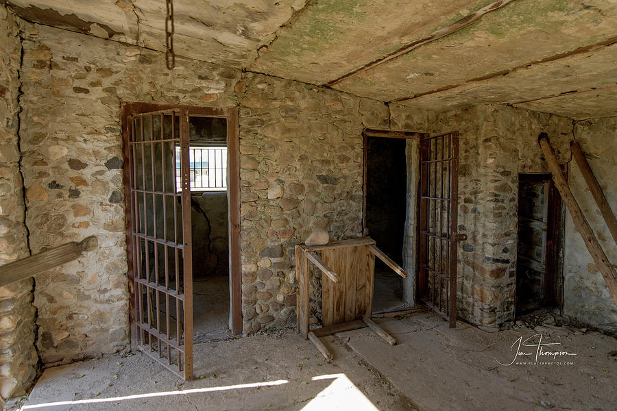 Abandoned Building Photograph - The Stone Jailhouse Interior by Jim Thompson