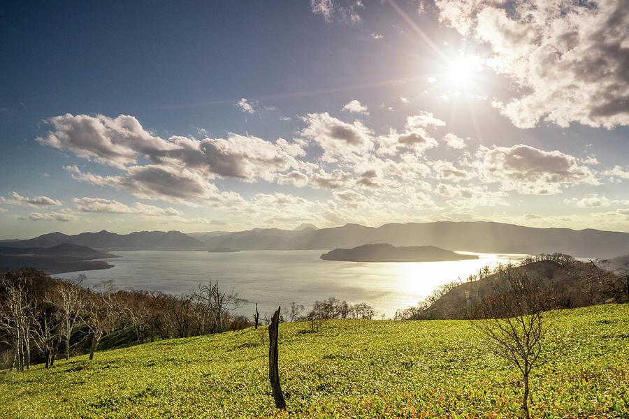 The Sun and Lake Kussharo - Hokkaido, Japan by Ellie Teramoto