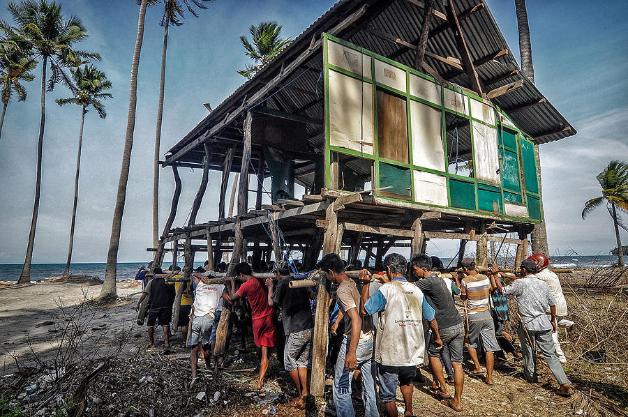 Action Photograph - The Tradition Of Moving Houses by Andinursam