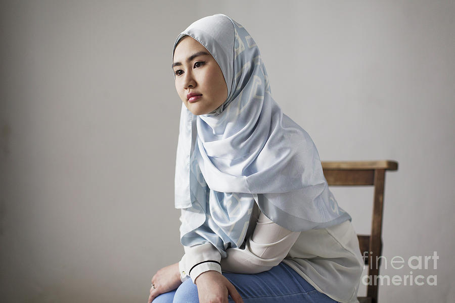 Anticipation Photograph - Thoughtful Young Woman In Blue Silk Hijab by Caia Image/science Photo Library
