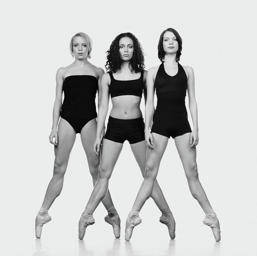 Three Ballerinas Standing On Tiptoe Photograph by Chris Nash