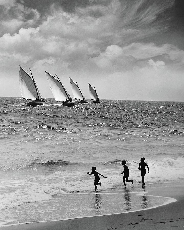 Three Boys Running Along Beach Photograph by Stockbyte