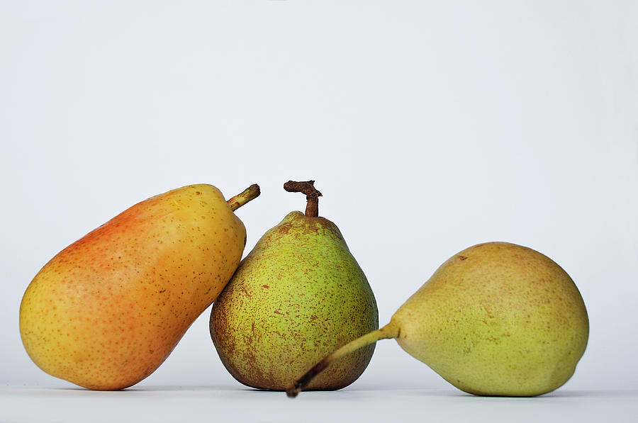 Three Diferent Pears Isolated On Grey Photograph by Irantzu Arbaizagoitia Photography
