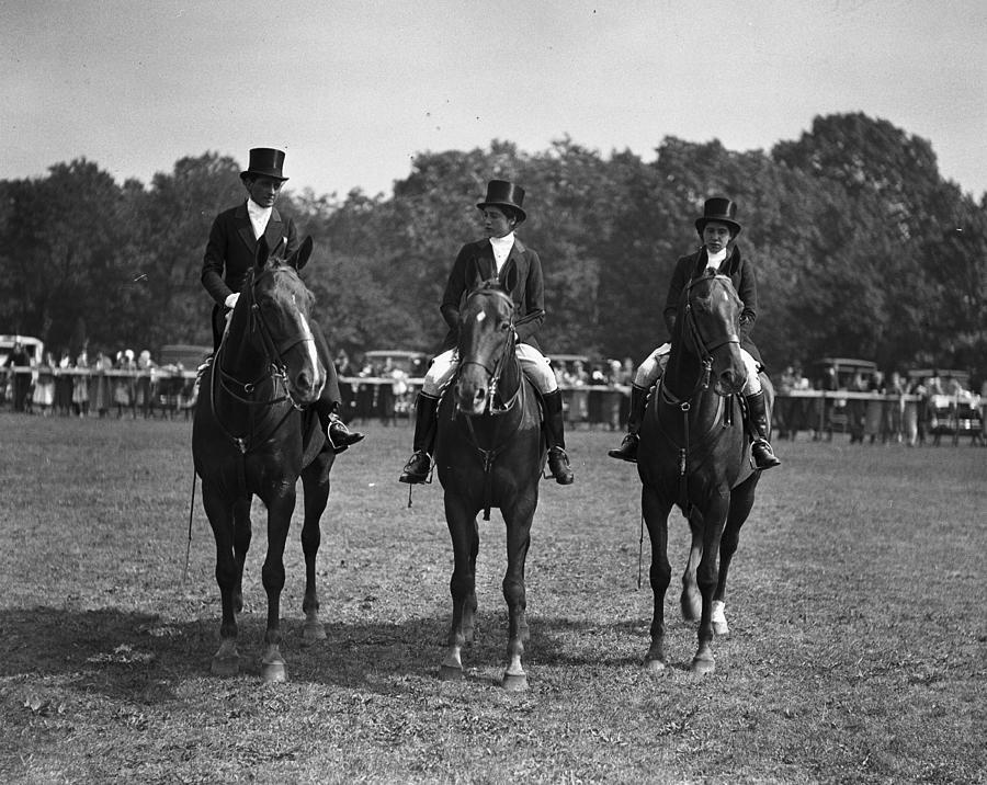 Three Equestrians Ride Horses At A Show Photograph by Bert Morgan
