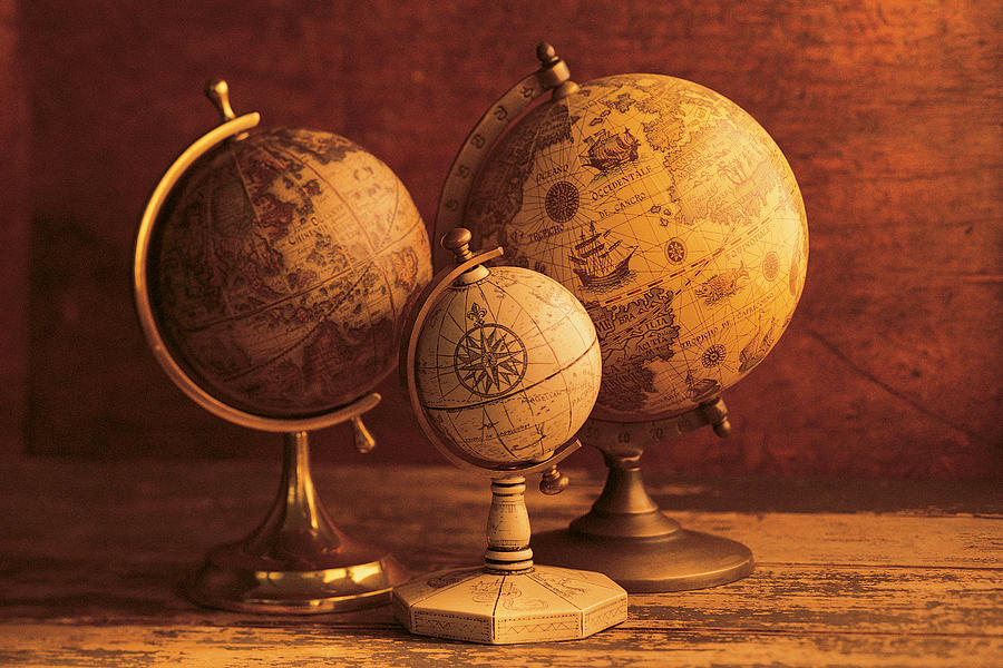 Three Globes With World Map Backdrop Photograph by Comstock